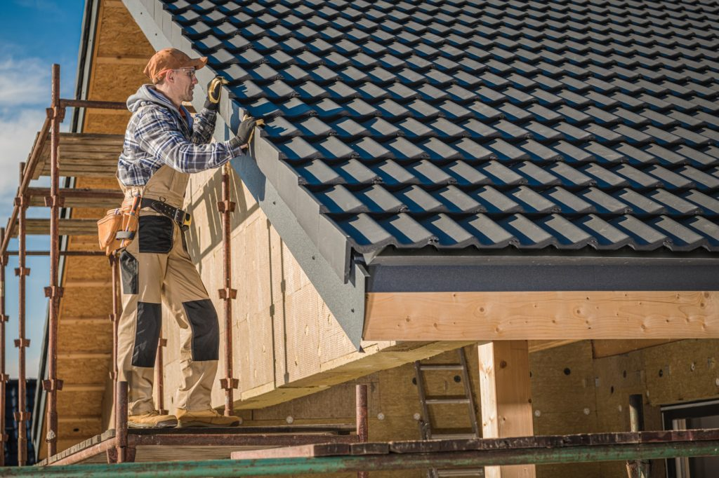 roofer installing a new roof
